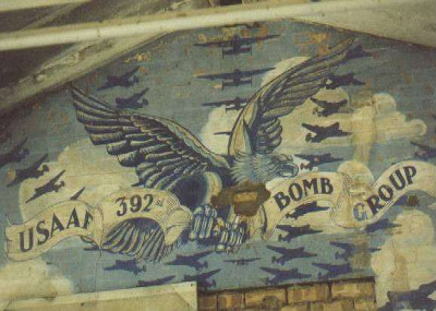 depicts a an eagle clutching a banner of the 392nd Bomb Group